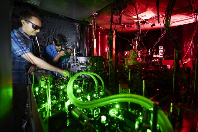 Scientists working on a laser tabletop in ne of the quantum research laboratories at LMU München.